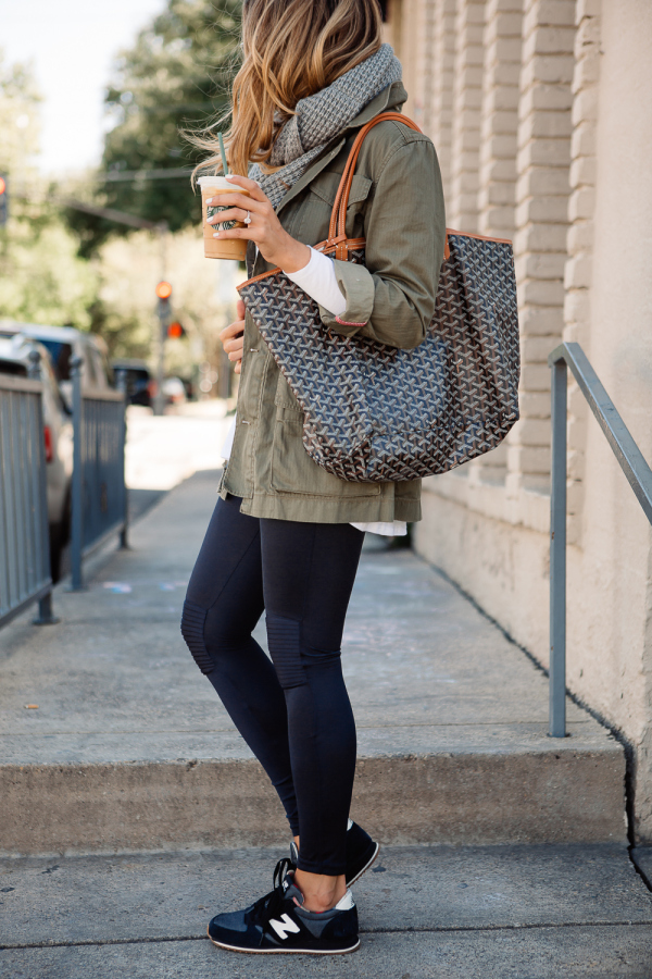 Ashley Robertson wears a khaki army jacket over black leggings; completing the look with a chunky knit scarf. Jacket/Scarf: J Crew, Leggings: Olympia, Top: Blue Life.