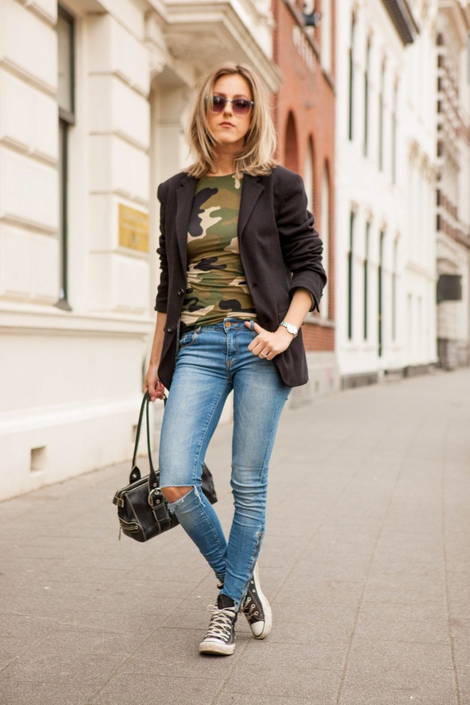 Anna Belle Clarenburg is wearing a camouflage top from River Island, blazer from Zara, jeans from Supertrash and the sneakers are from Converse