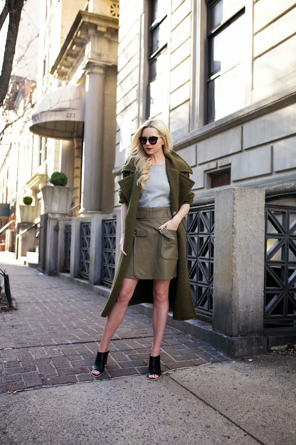 Military Style Fashion Trend: Blair Eadie is wearing an army green Stylenanda coat with a khaki leather and grey Derek Lam 10 Crosby dress