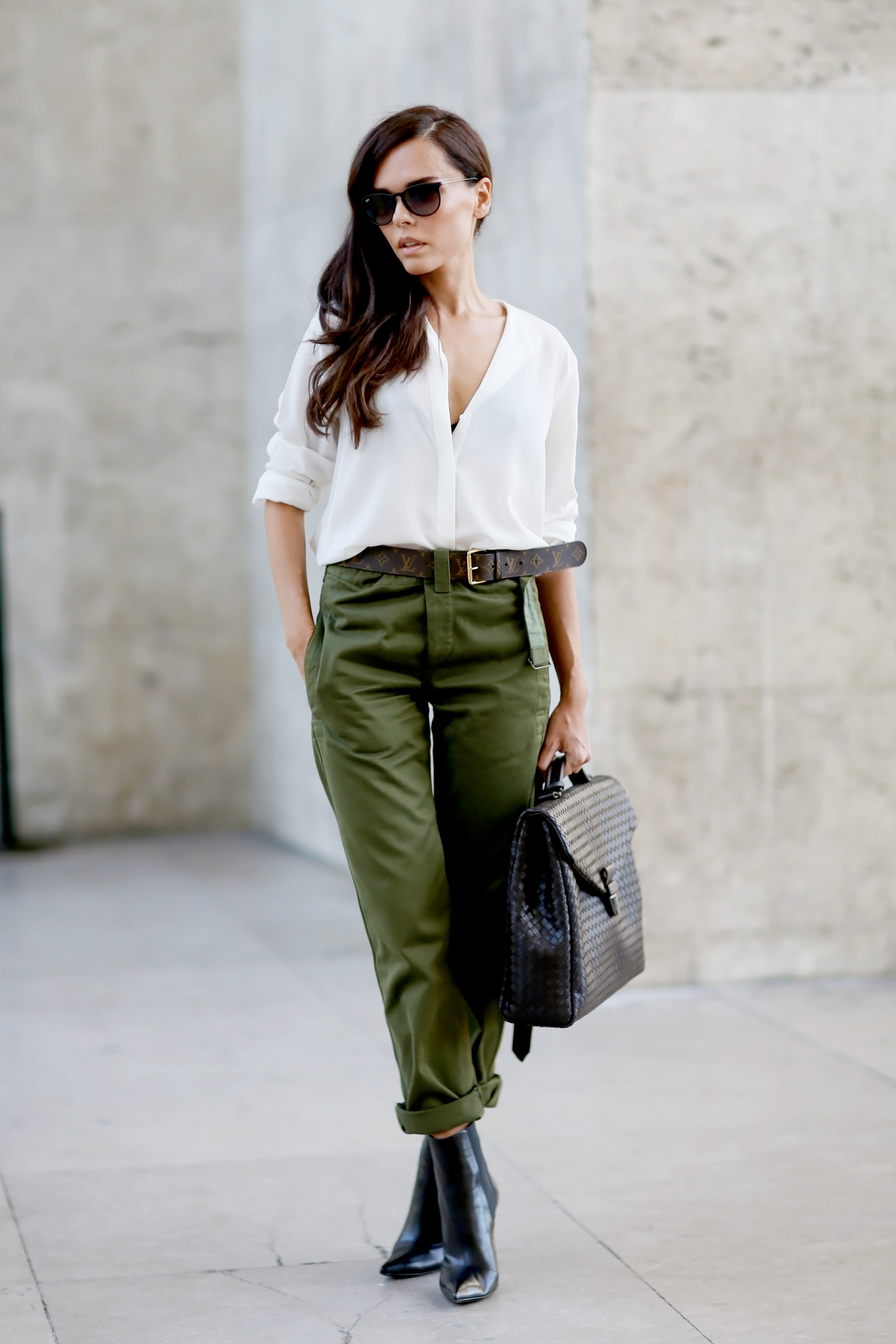 Jessie Bush is wearing a khaki green army trousers accessorised with a Louis Vuitton belt